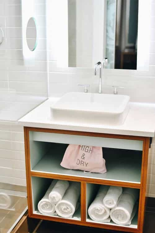 sink with racks to hold towel